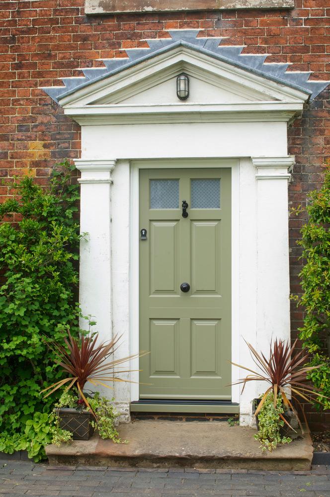 Green front entrance door black furniture etched glass panel