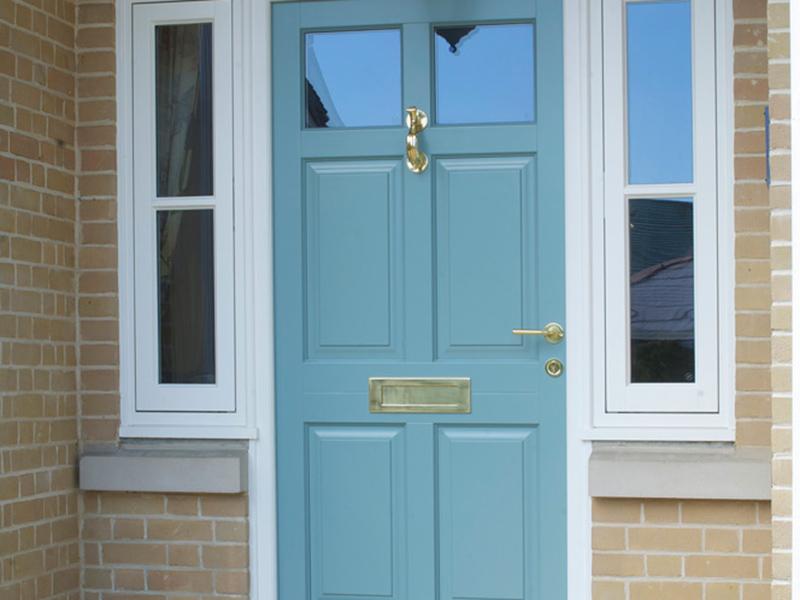 blue front entrance door top side light brass furniture