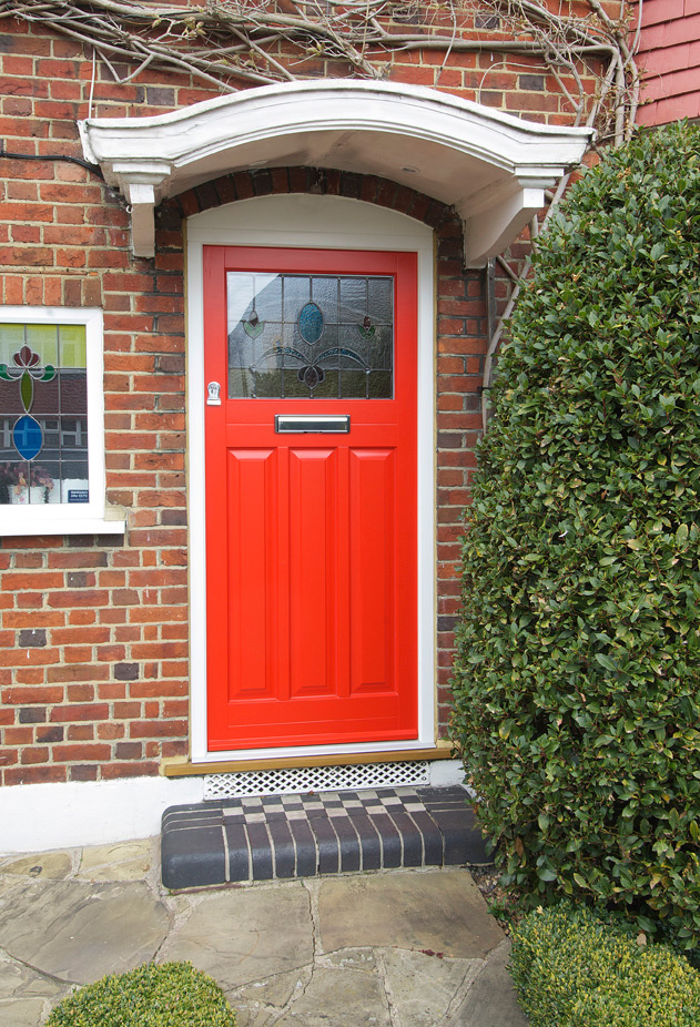 red front entrance door stained glass panel chrome furniture